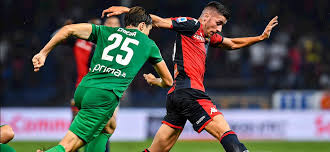 Una delle azioni di gioco di Genoa-Fiorentina